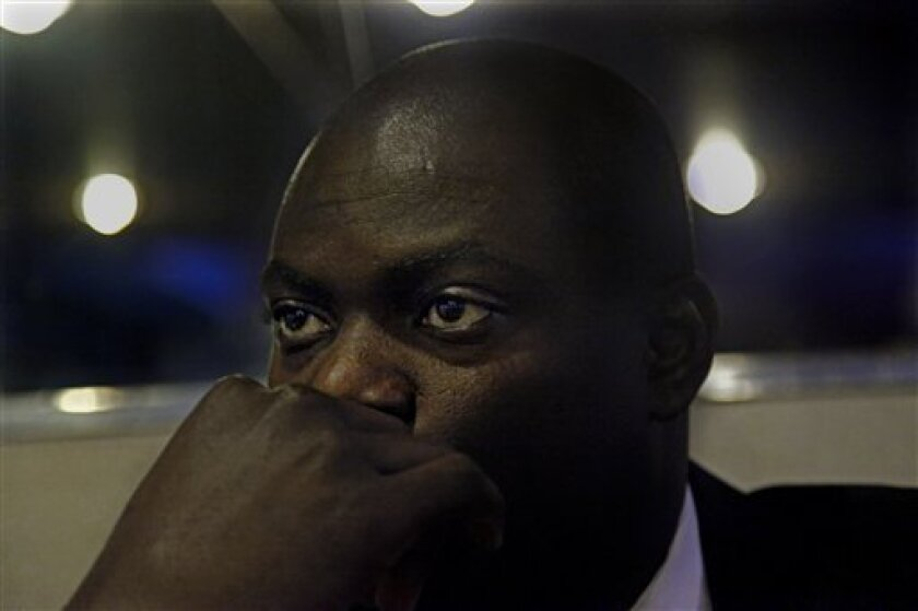 In this March 10, 2011 photo, tenor Nelson Hebo prepares to sing in a concert with prominent and rising opera stars at the Church of the Heavenly Rest in New York. Nelson's journey has been an odyssey as dramatic and surreal as any opera. It has swept him from the war-ravaged streets of Luanda to t