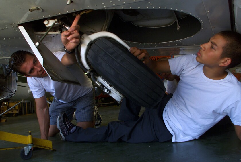 Students check out landing gear recently at the aviation mechanics schools operated by the Los Angeles Unified School District at Van Nuys Airport. The vocational program was saved from closure in May.