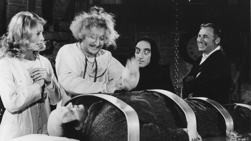 """Brooks, right, directs, from left, Teri Garr, Gene Wilder, Marty Feldman, and Peter Boyle (lying down) on the set of """"Young Frankenstein"""" on March 27, 1974."""