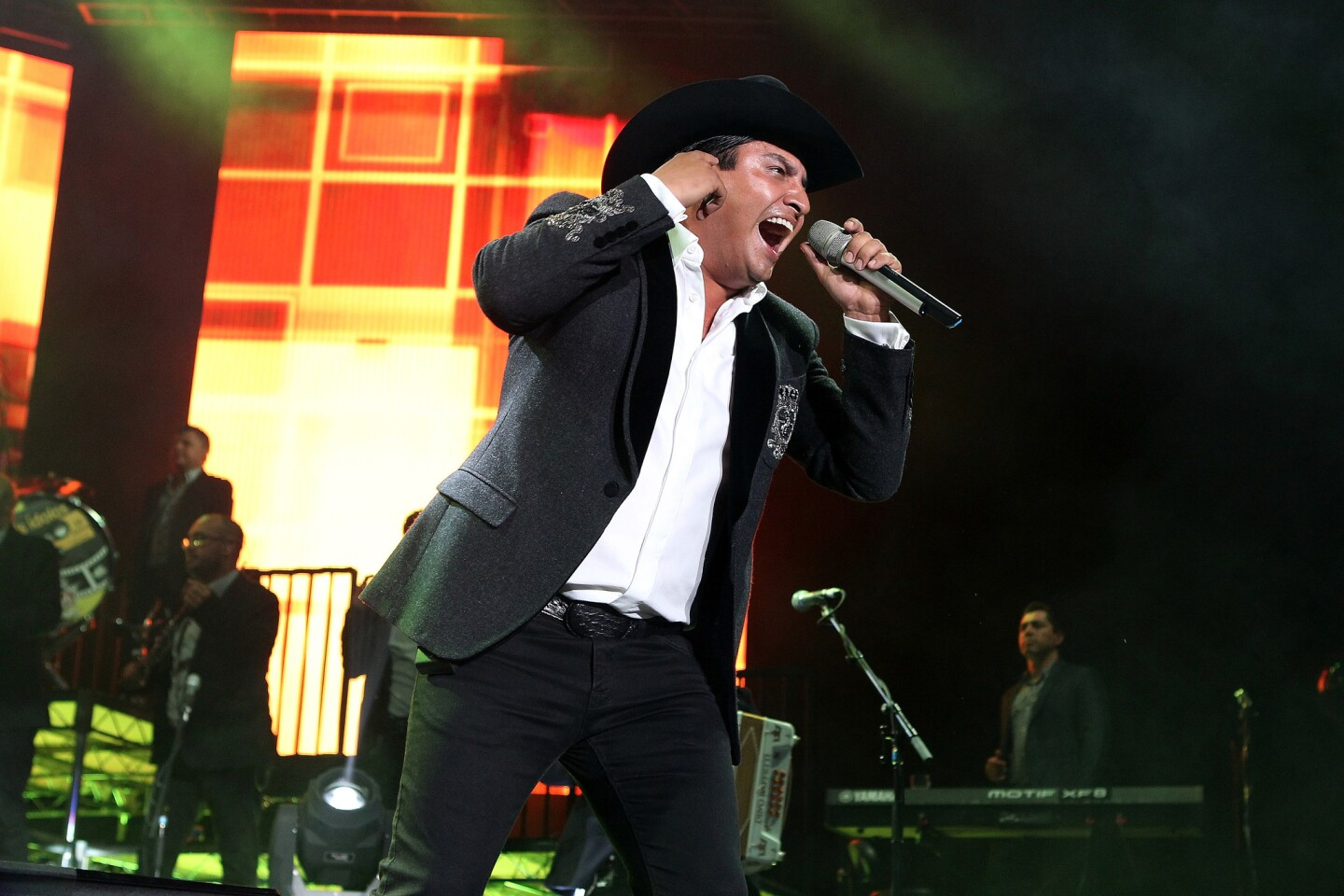 """Julion Alvarez performs onstage during """"Mis IdolosÉHoy Mis Amigos Tour"""" at The Forum on July 16, 2016 in Inglewood, CA. (Photo by © Art. Garcia/DDPixels.com)"""
