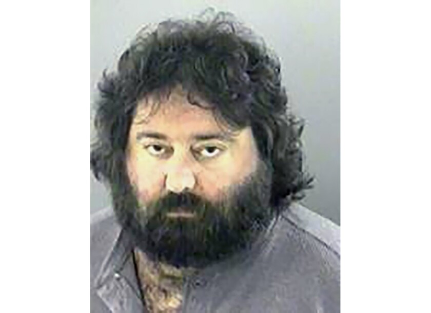 FILE - This undated booking photo released by the Gwinnett County Sheriff's Office, shows Ed Kramer. A grand jury has indicted a Georgia judge, along with Kramer a co-founder of DragonCon, and two others, on Wednesday, Sept. 18, 2019, after prosecutors accused them of illegally accessing a courthouse computer network. (Gwinnett County Sheriff's Office via AP)
