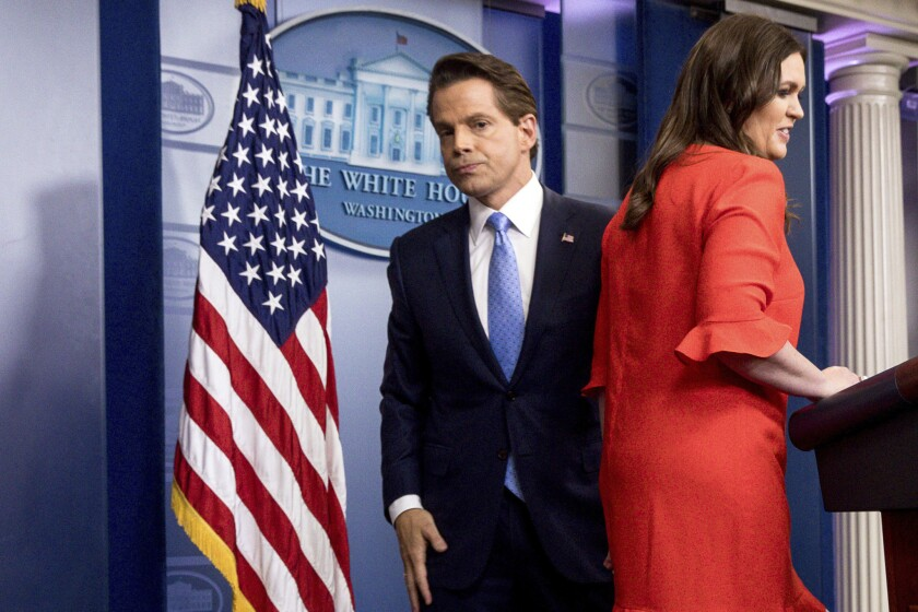 White House press secretary Sarah Huckabee Sanders takes the podium as Anthony Scaramucci, White House communications director departs.