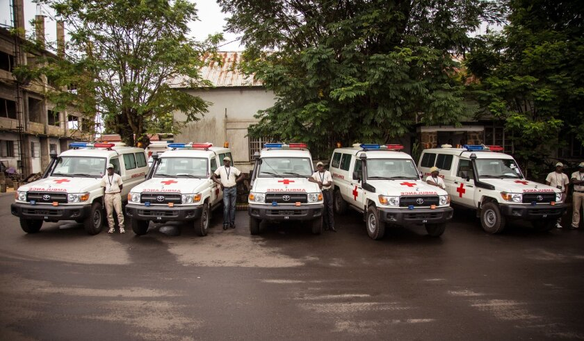 Five ambulances that were donated by the U.S. to help combat the Ebola virus are lined up following a ceremony attended by Sierra Leone's president Ernest Bai Koroma, in Freetown, Sierra Leone, Wednesday, Sept. 10, 2014. The United States donated five ambulances Wednesday to help Sierra Leone's fight against Ebola, as the West African government acknowledged it can take up to 24 hours to pick up bodies in the spiraling crisis. (AP Photo/Michael Duff)