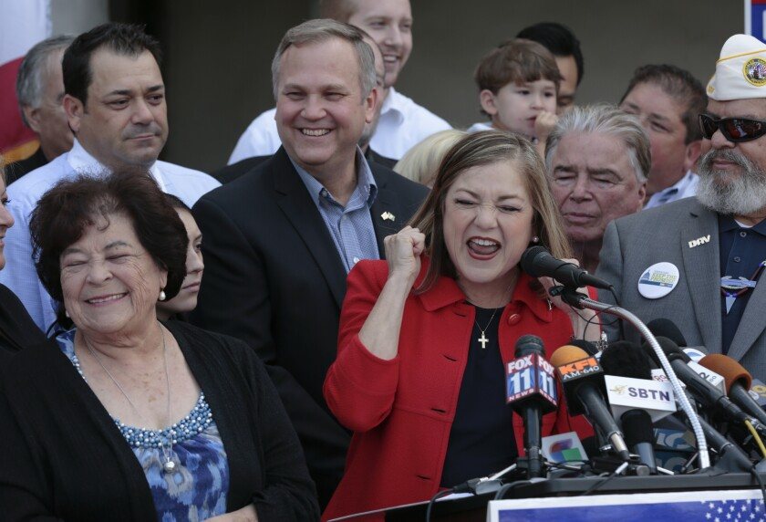 With her mother, Maria Macias, left, and her husband Jack Einwechter behind her, Rep. Loretta Sanchez announces that she will run for Barbara Boxer's seat in the U.S. Senate in May, 2015.