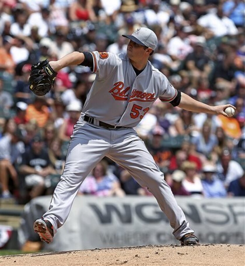Baltimore Orioles starter Zach Britton pitches to the Chicago White Sox in the first inning in a baseball game in Chicago on Thursday, July 4, 2013. (AP Photo/Charles Cherney)