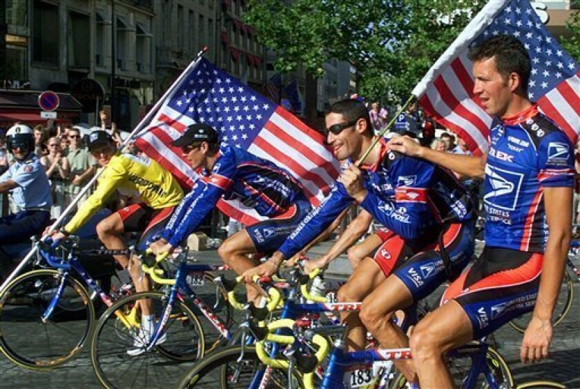 FILE - This July 25, 1999, file photo shows Tour de France winner Lance Armstrong of the U.S. left, riding down the Champs Elysees avenue with teammates, from left, Frankie Andreu, of the U.S., George Hincapie of the U.S., and Pascal Derame, of France, after the 20th and final stage of the Tour de France cycling race, in Paris, France. While Floyd Landis accuses Lance Armstrong of taking drugs and approving systematic doping, former teammates say that image doesn't conform with their experience. (AP Photo/Laurent Rebours, File)