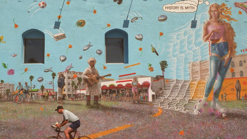 """A cyclist rides past the second version of a mural by artist Rip Cronk--which was then titled """"Venice Reconstituted""""--in 1996. A newer, slightly different version of the piece, painted by Cronk on the same wall in 2011 and visible in Venice today, is named """"Venice Kinesis."""""""