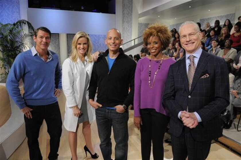 """This undated photo provided by ABC shows the hosts of the network's new daily talk show, """"The Revolution,"""" from left, Ty Pennington, Dr. Jennifer Ashton, Harley Pasternak, Dr. Tiffanie Davis Henry and Tim Gunn. The show debuts on Monday, Jan. 16, 2012. (AP Photo/ABC, Lorenzo Bevilaqua)"""