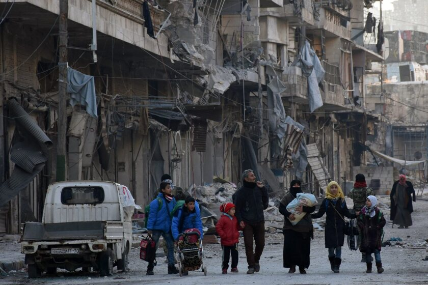 People carrying their belongings leave the eastern neighborhoods of Aleppo, Syria, on Dec. 7, 2016.