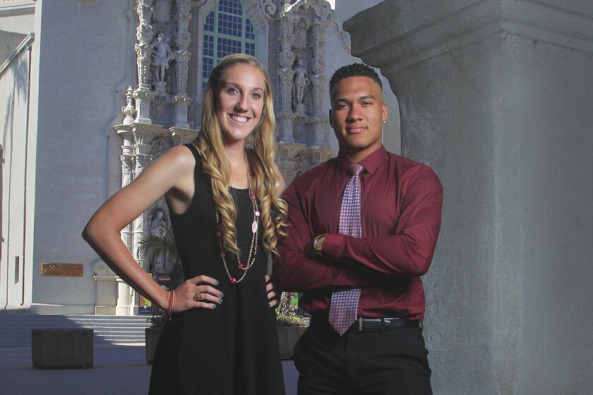 Academic Athletes of the Year Caitlin Cole of Del Norte and Jimmie Hill of Mar Vista are shown outside the Museum of Man in Balboa Park.