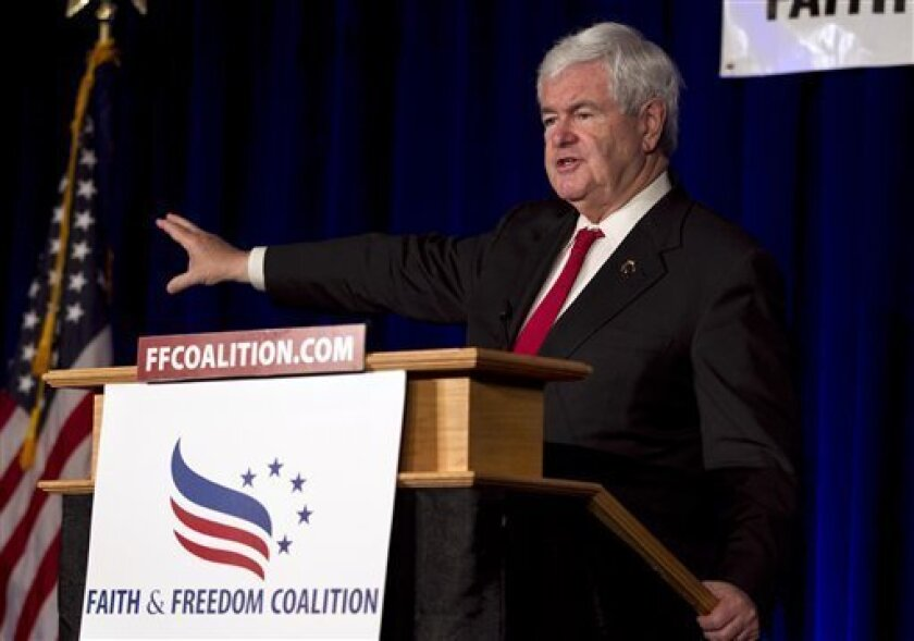 Republican presidential candidate Newt Gingrich speaks to an audience of the Wisconsin Faith & Freedom Coalition during a campaign stop in Pewaukee, Wis., Saturday, March 31, 2012. (AP Photo/Steven Senne)