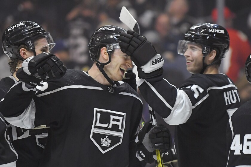 Kings center Gabriel Vilardi is congratulated by defenseman Ben Hutton, right,  after a 5-4 victory over the Florida Panthers on Thursday. Vilardi scored a goal in the first period.