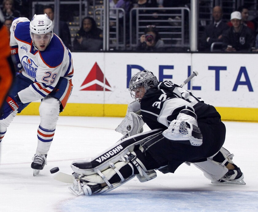 Kings goalie Jonathan Quick (32) blocks a shot by Oilers forward Leon Draisaitl (29)during the first period of a game on March 26.