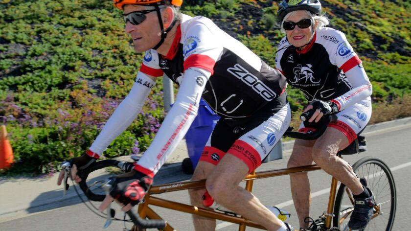 Dorothy Deans riding behind partner Paul Dickstein in Solana Beach Friday. photo by Bill Wechter