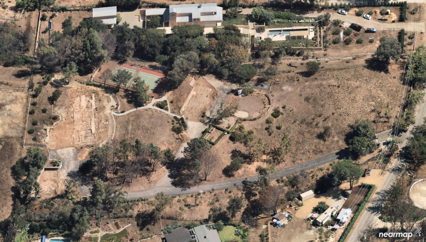 The four-plus-acre property near Zuma Beach was the site of a European-inspired farmhouse. The Doug Burdge-designed home was destroyed by the 2018 Woolsey fire.