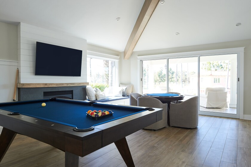 An open area on the second floor of Brad and Jacquie Cox's Coronado home is the entertainment hub for friends and family.