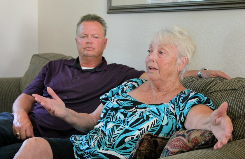 Bill Wright Jr. and his mother, Nancy Wright, discuss fire chief Bill Wright's experience at Elmcroft of La Mesa