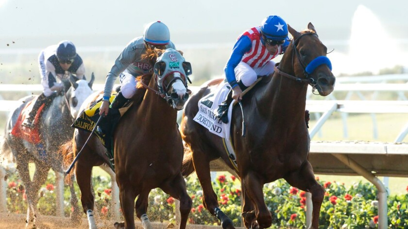 California Chrome holds off Dortmund, right, during the San Diego Handicap at Del Mar on July 23.