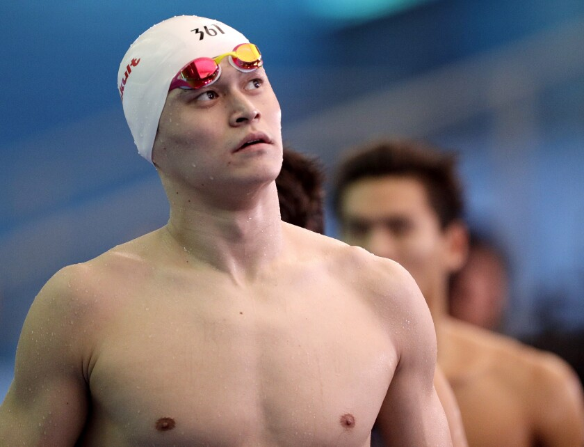 FILE - In this July 26, 2019, file photo, China's Sun Yang leaves the pool deck following the men's 4x200m freestyle relay heats at the World Swimming Championships in Gwangju, South Korea. Chinese swimmer star Sun Yang has been banned for more than four years for breaking anti-doping rules. The verdict by the Court of Arbitration for Sport ends Sun's hopes of defending his Olympic title in the 200 meters freestyle in Tokyo next month. His ban expires in May 2024. (AP Photo/Mark Schiefelbein, File)