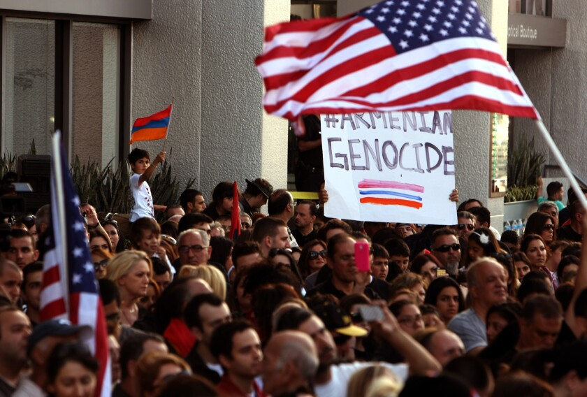 Marking the 99th anniversary of the Armenian genocide, hundreds of people protest in front of the Turkish embassy in mid city Los Angeles on April 24, 2014.
