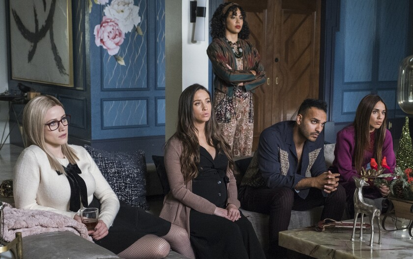"""Olivia Taylor Dudley, left, Stella Maeve, Riann Steele, Arjun Gupta and Summer Bishil in """"The Magicians"""" on Syfy."""