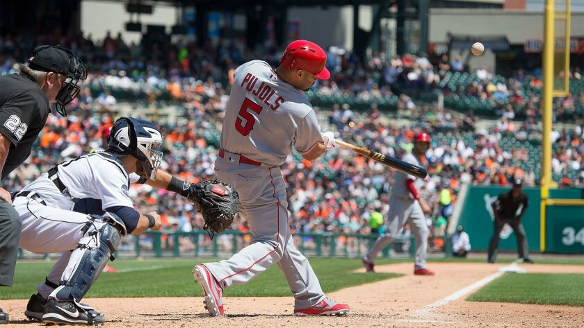 DETROIT, MI - JUNE 08: Albert Pujols #5 of the Los Angeles Angels of Anaheim hits a sacrifice fly in