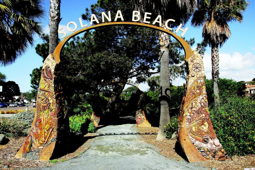 Betsy Schulz' two arches at the southern end of the Solana Beach Coastal Rail Trail depict the city's history. CREDIT: Priscilla Lister