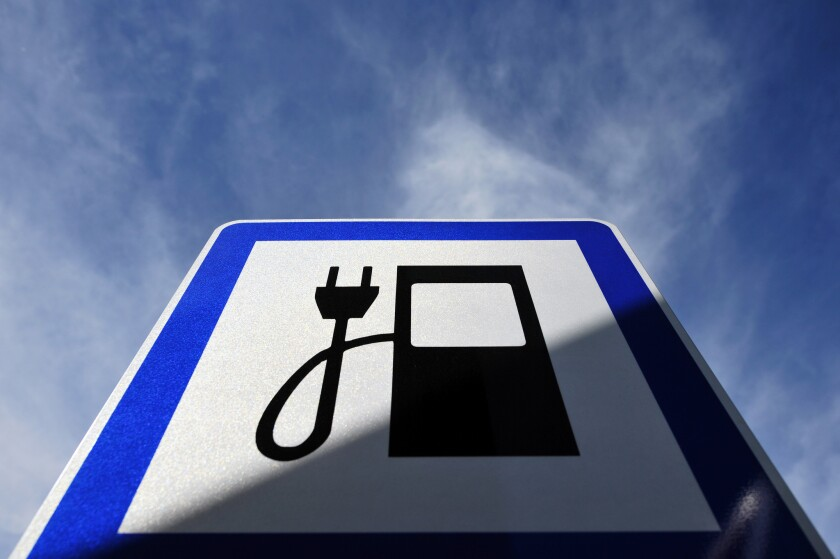 In this file photo taken on Oct. 17, 2012, a road sign directing electric car drivers to a nearby charging station is shown in Sofia, Bulgaria.