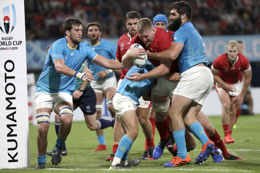 Wales' Bradley Davies runs at the defence during the Rugby World Cup Pool D game at Kumamoto Stadium between Wales and Uruguay in Kumamoto, Japan, Sunday, Oct. 13, 2019. (AP Photo/Aaron Favila)
