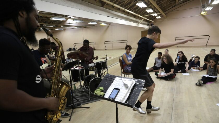 LOS ANGELES, CA -- JUNE 26, 2019: Colton Hagler, 15, taps with a live band during the Tap Music Proj