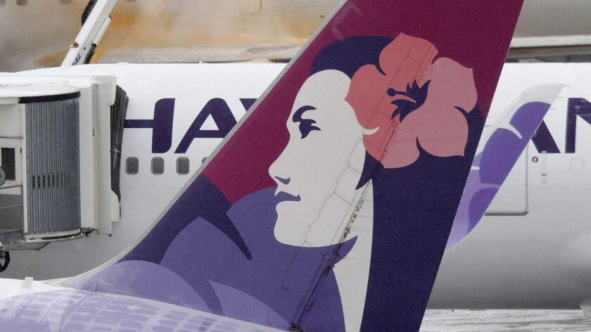 FILE - In this Jan. 19, 2012 file photo, icicles can be seen on a Hawaiian Airlines plane as others