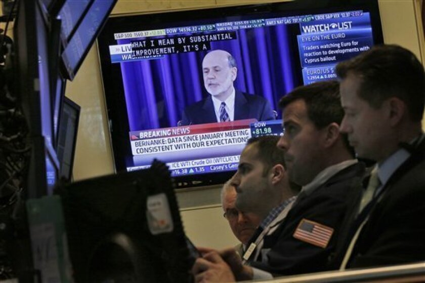 A television screen on the floor of the New York Stock Exchange shows the news conference of Federal Reserve Chairman Ben Bernanke, Wednesday, March 20, 2013. In a statement after a two-day meeting, the Fed stood by its plan to keep short-term rates at record lows at least until unemployment falls