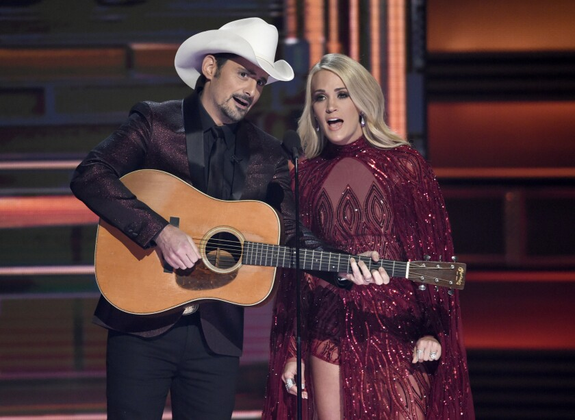 Co-hosts Brad Paisley and Carrie Underwood perform Wednesday night at the 51st CMA Awards in Nashville.