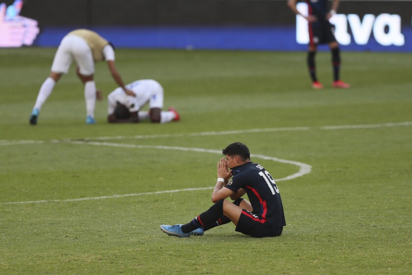 U.S. player Sebastian Soto reacts after the U.S. failed to qualify for the Olympics following a 2-1 loss to Honduras.