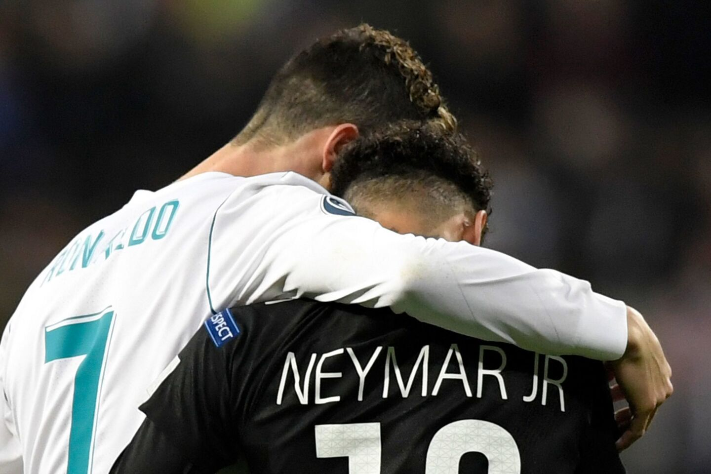 Real Madrid's Portuguese forward Cristiano Ronaldo (L) and Paris Saint-Germain's Brazilian forward Neymar leave the pitch during the UEFA Champions League round of sixteen first leg football match Real Madrid CF against Paris Saint-Germain (PSG) at the Santiago Bernabeu stadium in Madrid on February 14, 2018. / AFP PHOTO / GABRIEL BOUYSGABRIEL BOUYS/AFP/Getty Images ** OUTS - ELSENT, FPG, CM - OUTS * NM, PH, VA if sourced by CT, LA or MoD **