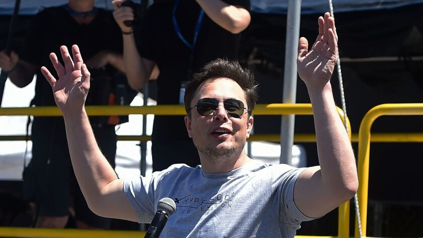 Elon Musk speaks at the SpaceX Hyperloop Pod Competition in Hawthorne in July.