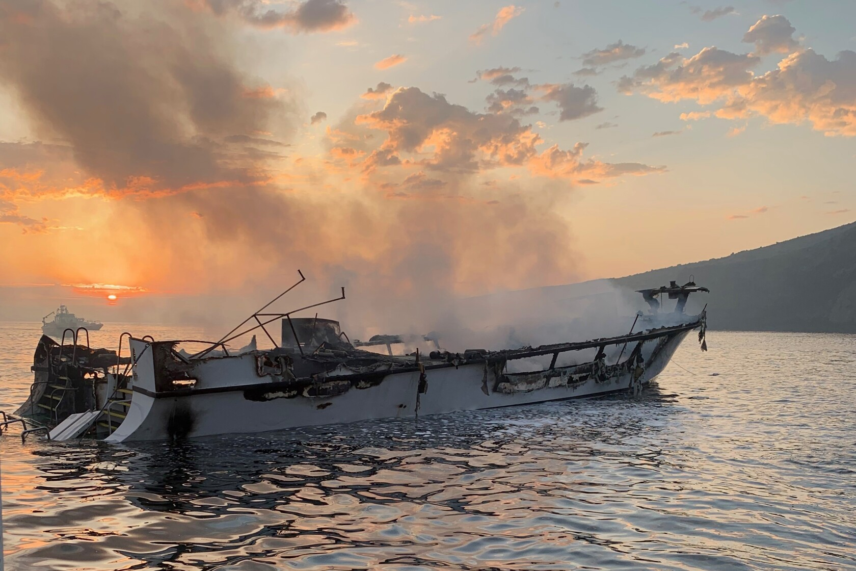 Biologist missing in boat fire had 'a love for marine life'