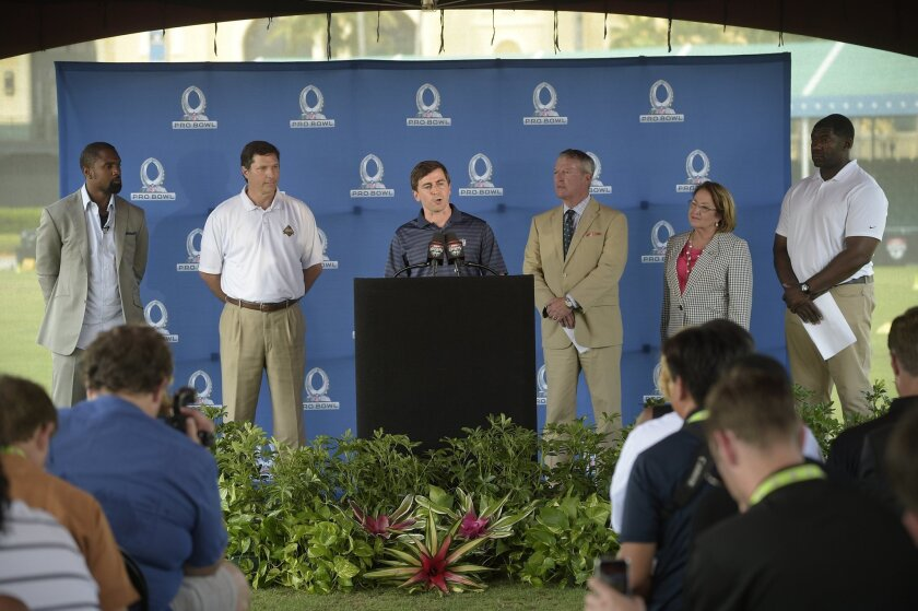 Peter O'Reilly, NFL Senior Vice President of Events, announces Orlando, Fla., as the new host for the NFL Pro Bowl football game during a news conference in Kissimmee, Fla., Wednesday, June 1, 2016. Standing with him are former NFL defensive back Charles Woodson, left, Steven Hogan, CEO of Florida