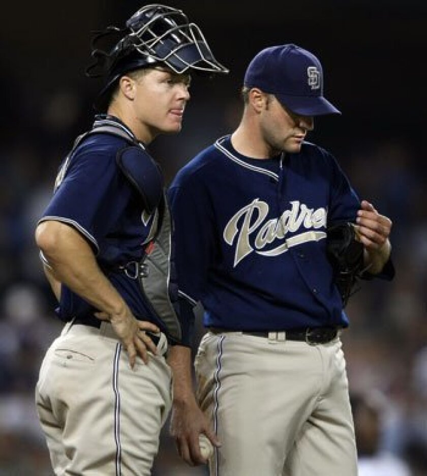 pitcher Shawn Estes, shown in this file photo with catcher Nick Hundley, was released to free agency along with Josh Bard on Monday.
