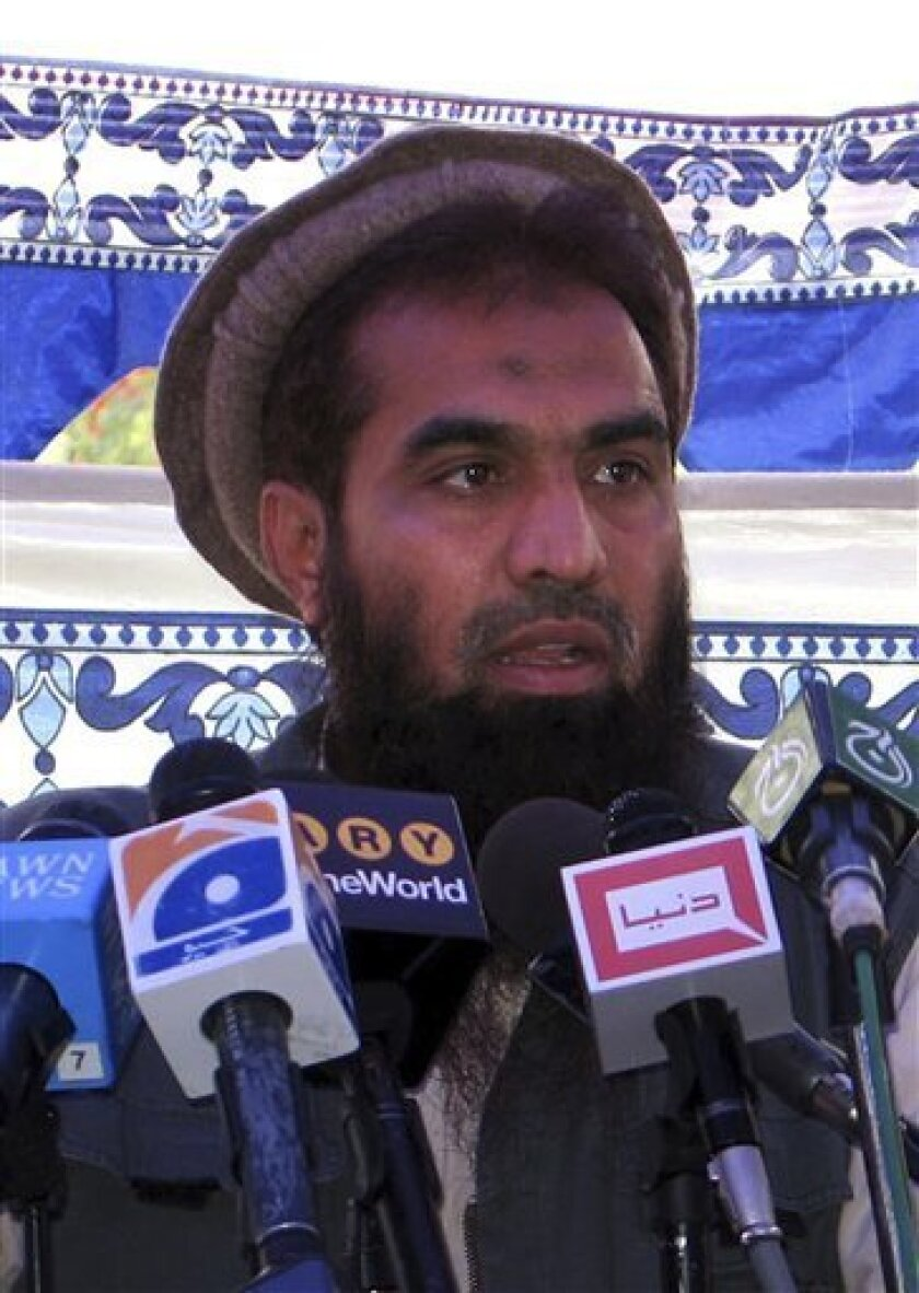 In this file photo dated June 28, 2008, Pakistani Zaki-ur-Rehman Lakhvi speaks during a rally at Muzaffarabad, in Pakistani controlled Kashmir, Pakistan, Saturday, June 28, 2008. Security forces overran a militant camp on the outskirts of Pakistani Kashmir's main city and seized an alleged masterm