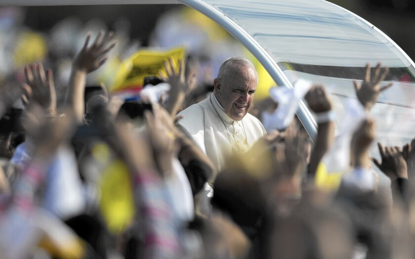 Pope Francis arrives to celebrate a Mass in Asuncion, Paraguay. Earlier he visited a slum to talk about equality. Paraguay is the final leg of his tour of three of South America's poorest countries; he also visited Ecuador and Bolivia.
