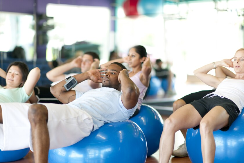 People exercising on exercise balls