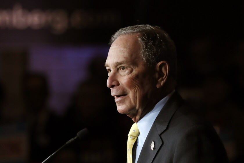 Democratic presidential candidate and former New York City Mayor Michael Bloomberg talks to supporters Tuesday, Feb. 4, 2020 in Detroit. (AP Photo/Carlos Osorio)