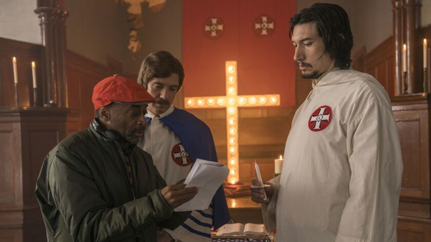 "Spike Lee, left, with actors Topher Grace, center, and Adam Driver on the set of Lee's film ""BlacKkKlansman."""