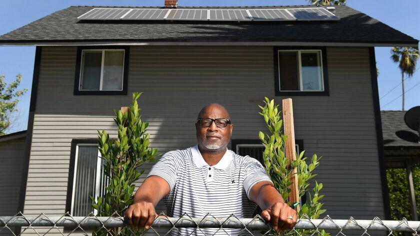 PASADENA, CALIFORNIA APRIL 10, 2018-Home owner Reginald Nemore stands in front of his Pasadena home