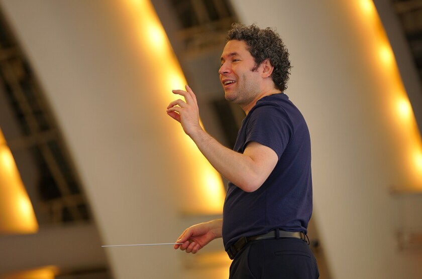 Gustavo Dudamel gestures as he talks to the orchestra.