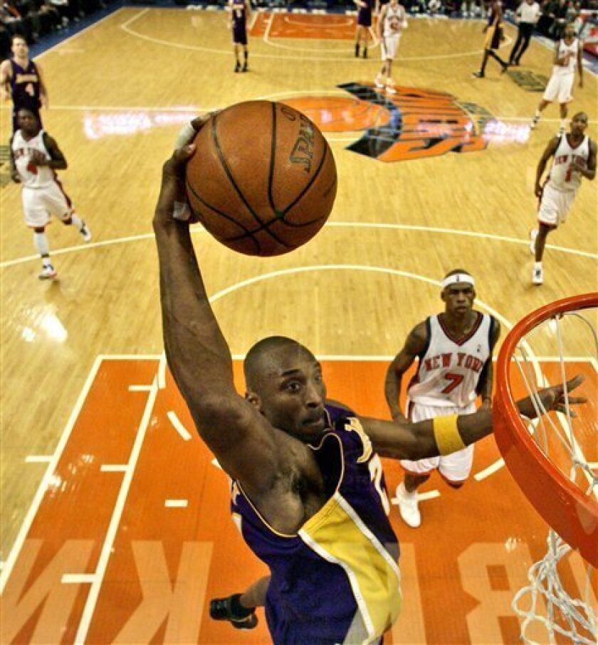 Los Angeles Lakers guard Kobe Bryant (24) prepares to dunk the ball against New York Knicks forward Al Harrington (7) in the second quarter during an NBA basketball game at Madison Square Garden in New York, Monday, Feb. 2, 2009. Bryant had 61 points in the game as the Lakers won 126-117. (AP Photo/Kathy Willens)
