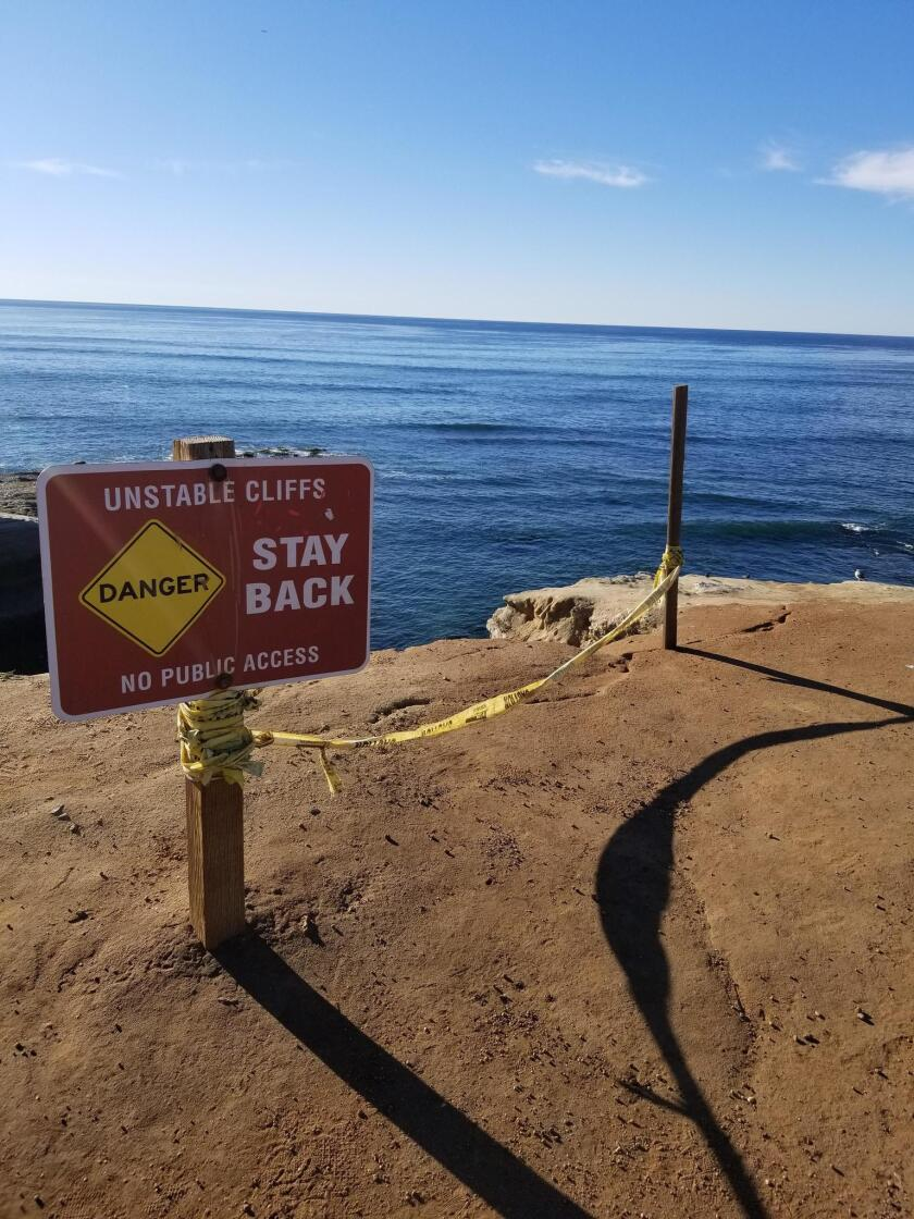 Signage along Sunset Cliffs Boulevard warns park guests of the unstable cliff sides.