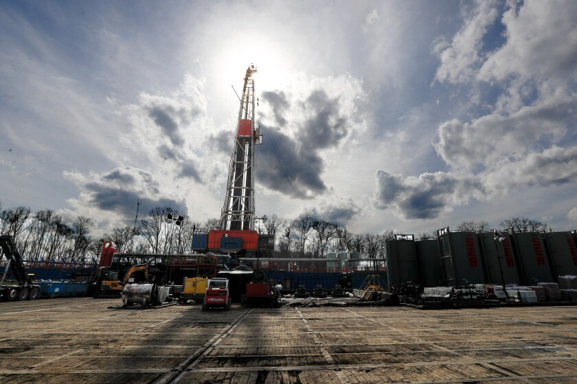 FILE - In this March 12, 2020, file photo, the sun shines through clouds above a shale gas drilling site in St. Mary's, Pa. In a late gambit to win the battleground state of Pennsylvania, President Donald Trump and his GOP allies have intensified attacks on Joe Biden over fracking, hoping to drive a wedge between the former vice president and the white, working-class voters tied to the state's booming natural gas industry. (AP Photo/Keith Srakocic, File)
