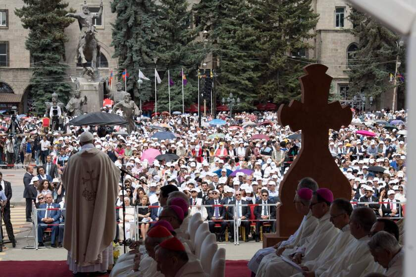 Pope Francis leads an open-air Mass in Vartanants Square in Gyumri, Armenia's second-largest city.